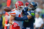 Tight end Jimmy Graham #88 of the Seattle Seahawks can't make the catch as defensive back Daniel Sorensen #49 of the Kansas City Chiefs defends on the play at CenturyLink Field on August 25, 2017 in Seattle, Washington. Sorensen was called for interference.