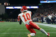 Tyreek Hill #10 of the Kansas City Chiefs catches a touchdown pass against the  New England Patriots in the fourth quarter at Gillette Stadium on October 14, 2018 in Foxborough, Massachusetts.