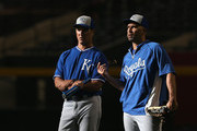 Bench coach Don Wakamatsu #22 and Raul Ibanez #18 of the Kansas City Royals talk on the field before the MLB game at Chase Field on August 5, 2014 in Phoenix, Arizona.