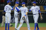 (L-R) Rosell Herrera #7, Alex Gordon #4, Adalberto Mondesi #27 and Alcides Escobar #2 of the Kansas City Royals celebrate a win over the Chicago White Sox at Guaranteed Rate Field on August 1, 2018 in Chicago, Illinois. The Royals defeated the White Sox 10-5.