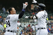 Nicholas Castellanos #9 of the Detroit Tigers celebrates his two-run home run with teammate with Miguel Cabrera #24 against the Kansas City Royals during the third inning at Comerica Park on April 21, 2018 in Detroit, Michigan.