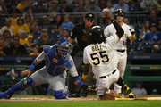 Josh Bell #55 of the Pittsburgh Pirates is tagged out at home plate by Salvador Perez #13 of the Kansas City Royals in the first inning during the game at PNC Park on September 19, 2018 in Pittsburgh, Pennsylvania.