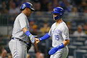 Whit Merrifield #15 of the Kansas City Royals celebrates with Salvador Perez #13 after scoring on an RBI double in the third inning against the Pittsburgh Pirates during inter-league play at PNC Park on September 17, 2018 in Pittsburgh, Pennsylvania.