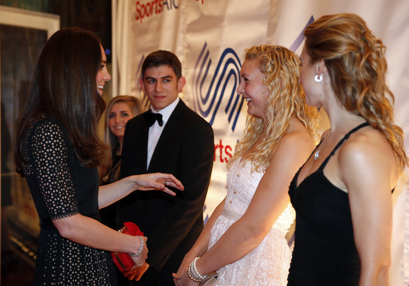 Kate Middleton Catherine, Duchess of Cambridge, (L), Patron of SportsAid charity, meets British rower Jess Leyden, 18, 2nd right, and other young athletes as she attends the SportsBall, the charity's annual gala dinner at Victoria Embankment Gardens on November 28, 2013  in London, England.