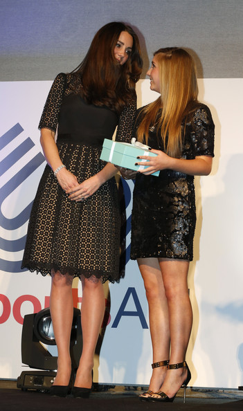 Kate Middleton Catherine, Duchess of Cambridge, patron of SportsAid charity, talks with shooter Amber Hill, 16, (R) after presenting the charity's this year's One-to-Watch Award at the SportsBall, the charity's annual gala dinner at Victoria Embankment Gardens on November 28, 2013  in London, England.