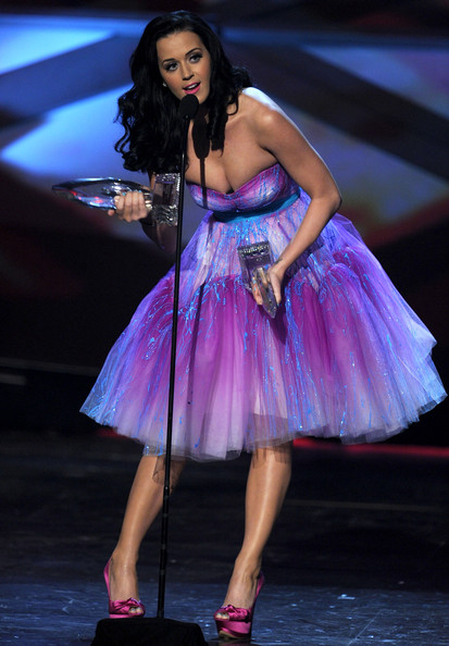 Katy Perry Singer Katy Perry aka Katy Brand accepts the Favorite Female Artist and Favorite Pop Artist awards onstage during the 2011 People's Choice Awards at Nokia Theatre L.A. Live on January 5, 2011 in Los Angeles, California.