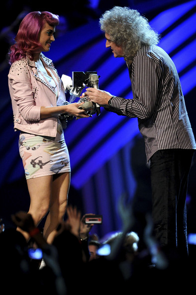 Katy Perry Brian May of Queen receives the award for Global Icon from singer Katy Perry during the MTV Europe Music Awards 2011 live show at at the Odyssey Arena on November 6, 20 11 in Belfast, Northern Ireland.