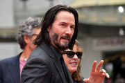 Keanu Reeves arrives for his handprint ceremony at the TCL Chinese Theatre IMAX forecourt on May 14, 2019 in Hollywood, California.