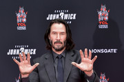 Keanu Reeves attends 'Keanu Reeves places his hand prints in cement' at TCL Chinese Theatre IMAX on May 14, 2019 in Hollywood, California.
