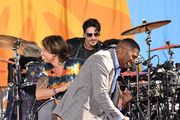 """Singer/songwriter Keith Urban (L) and media personality Michael Strahan perform On ABC's """"Good Morning America"""" at SummerStage at Rumsey Playfield, Central Park on August 09, 2019 in New York City."""