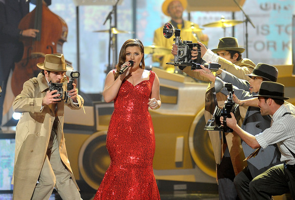 2011 American Music Awards - Show [yellow,fashion,dress,event,performance,camera operator,haute couture,fashion design,know it all,kelly clarkson,american music awards,c,california,los angeles,nokia theatre l.a. live,show]