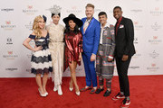 Figure skaters Tara Lipinski and Johnny Weir and Kirstin Maldonado, Scott Hoying, Mitch Grassi, and Kevin Olusola of the a cappella group Pentatonix attend Kentucky Derby 144 on May 5, 2018 in Louisville, Kentucky.