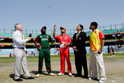 Captain Ashish Bagai of Canada takes the coin toss as captain Jimmy Kamande of Kenya looks on during the ICC Cricket World Cup group A match between Canada and Kenya at Feroz Shah Kotla stadium on March 7, 2011 in Delhi, India.
