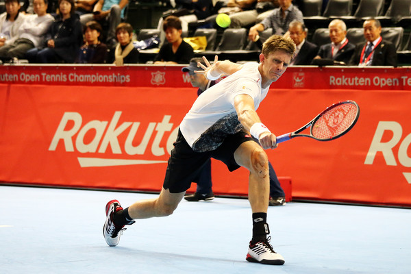 Rakuten Open - Day 4 [singles,sports,sports equipment,tennis racket,ball game,player,tennis player,tournament,tennis,racquet sport,sport venue,kevin anderson,frances tiafoe,backhand,south africa,united states,tokyo,chofu,rakuten open,round]