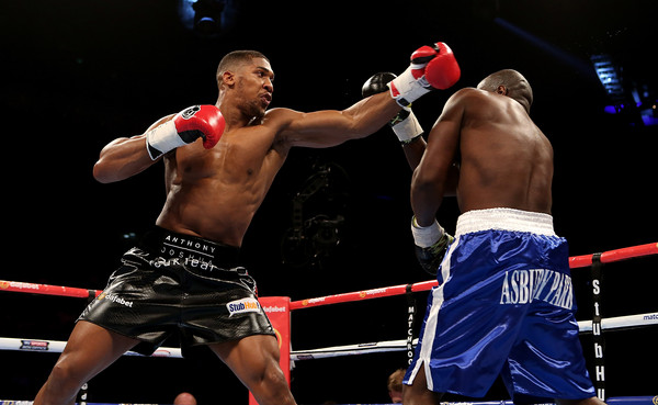 Boxing at O2 Arena [combat sport,boxing ring,barechested,sports,sport venue,contact sport,professional boxer,boxing,boxing glove,striking combat sports,anthony joshua,kevin johnson,exchange,o2 arena,england,usa,london,wbc international heavyweight,boxing,bout]