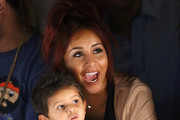 """TV Personality Nicole """"Snooki"""" Polizzi and her son Lorenzo Lavalle attend the Kids Rock! fashion show during Spring 2016 New York Fashion Week: The Shows at The Dock, Skylight at Moynihan Station on September 10, 2015 in New York City."""