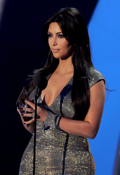 Kim Kardashian TV personality Kim Kardashian speaks onstage during the 2011 MTV Video Music Awards at Nokia Theatre L.A. LIVE on August 28, 2011 in Los Angeles, California.
