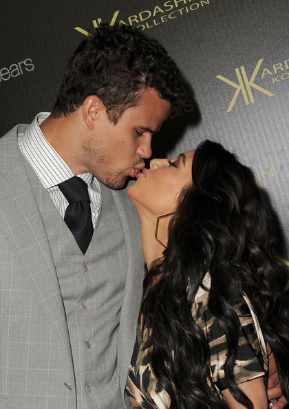 Kim Kardashian Reality TV star Kim Kardashian and New Jersey Nets forward basketball player Kris Humphries kiss on the red carpet of the Kardashian Kollection Launch Party on August 17, 2011 in Hollywood, California.