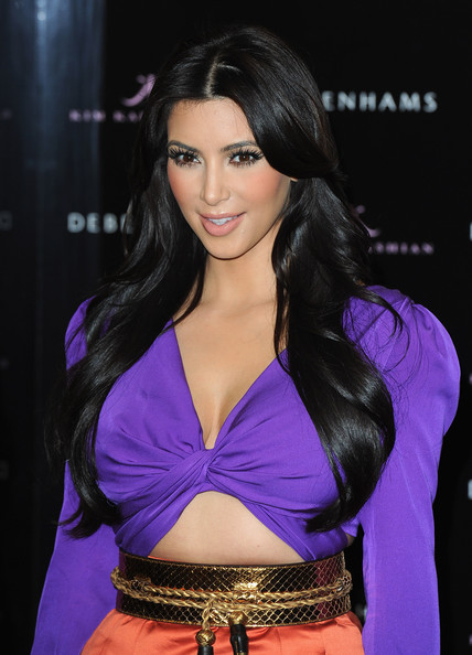 Kim Kardashian Kim Kardashian poses during her fragrance launch at Debenhams on June 8, 2011 in London, England.