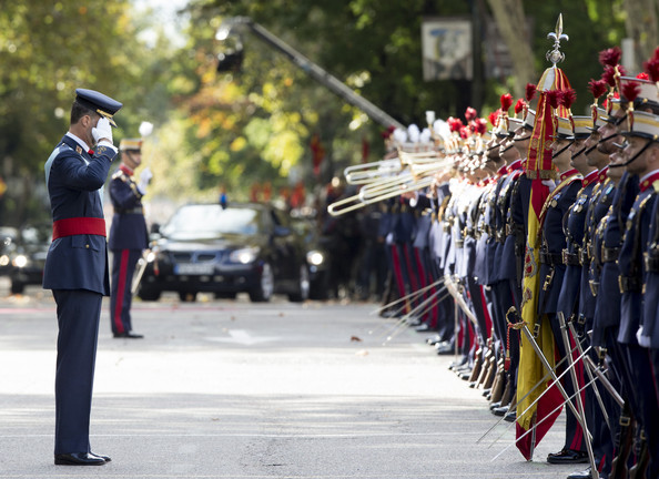Spanish Royals Attend National Day Military Parade 2014