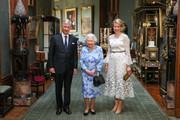 Queen Elizabeth II poses with King Philippe of Belgium and Queen Mathilde of Belgium in the Grand Corridor during their audience at Windsor Castle on July 14, 2018 in Windsor, England.
