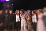 "This image has been taken with lens baby) (L-R) Sean Harris, Tom Glynn-Carney, Timothée Chalamet, director David Michod, Lily-Rose Depp and Joel Edgerton attend ""The King"" red carpet during the 76th Venice Film Festival at Sala Grande on September 02, 2019 in Venice, Italy."