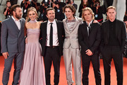 "(R-L) Sean Harris, Tom Glynn-Carney, Timothée Chalamet, director David Michod, Lily-Rose Depp and Joel Edgerton attend ""The King"" red carpet during the 76th Venice Film Festival at Sala Grande on September 02, 2019 in Venice, Italy."