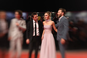 "This image has been taken with lens baby) (L-R) Timothée Chalamet, director David Michod, Lily-Rose Depp and Joel Edgerton attend ""The King"" red carpet during the 76th Venice Film Festival at Sala Grande on September 02, 2019 in Venice, Italy."