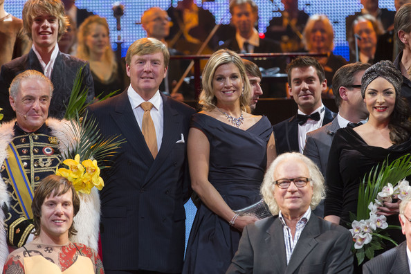 King Willem-Alexander of The Netherlands and Queen Maxima of The Netherlands pose with performers at the Circus Theatre for celebrations marking the 200th anniversary of the Kingdom of The Netherlands on November 30, 2013 in The Hague, Netherlands.