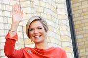 Queen Maxima of The Netherlands waves outside the Norwegian parliament Stortinget during an official visit to Oslo on October 2, 2013 in Oslo, Norway.