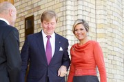 King Willem-Alexander of The Netherlands and Queen Maxima of The Netherlands stand outside the Norwegian parliament Stortinget during an official visit to Oslo on October 2, 2013 in Oslo, Norway.