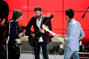 (L-R) Matthew Followill, Caleb Followill and Jared Followill of Kings Of Leon perform on stage on AT&T at iHeartRadio Theater LA on January 30, 2017 in Burbank, California.