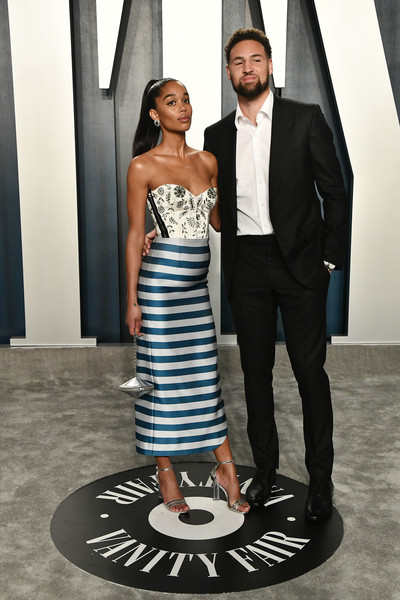 2020 Vanity Fair Oscar Party Hosted By Radhika Jones - Arrivals [fashion,clothing,blue,formal wear,dress,suit,shoulder,black-and-white,haute couture,tuxedo,radhika jones - arrivals,radhika jones,klay thompson,laura harrier,l-r,california,beverly hills,wallis annenberg center for the performing arts,oscar party,vanity fair,radhika jones,wallis annenberg center for the performing arts,vanity fair,oscar party,celebrity,hollywood,academy awards,blackkklansman,watch party,party]