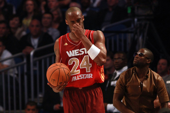 2012 NBA All-Star Game [photograph,basketball,basketball player,basketball moves,player,basketball court,team sport,sports,sportswear,ball game,kobe bryant,kevin hart,user,blood,end,foul,los angeles lakers,western conference,nba all-star game]