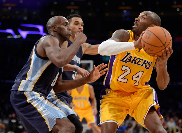 Memphis Grizzlies v Los Angeles Lakers [photograph,basketball,sports,basketball moves,basketball player,team sport,ball game,player,basketball court,tournament,kobe bryant,quincy pondexter 8,user,courtney lee 5,note,front,los angeles,memphis grizzlies,los angeles lakers]