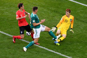 Hyeonwoo Jo of Korea Republic makes a save from a Mario Gomez of Germany chance during the 2018 FIFA World Cup Russia group F match between Korea Republic and Germany at Kazan Arena on June 27, 2018 in Kazan, Russia.