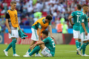 Sebastian Rudy of Germany consoles Mario Gomez of Germany who looks dejected following their sides defeat in the 2018 FIFA World Cup Russia group F match between Korea Republic and Germany at Kazan Arena on June 27, 2018 in Kazan, Russia.