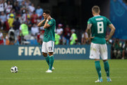Mario Gomez and Toni Kroos of Germany stand dejected following the 2018 FIFA World Cup Russia group F match between Korea Republic and Germany at Kazan Arena on June 27, 2018 in Kazan, Russia.