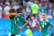 Joshua Kimmich of Germany stands dejected as Ju Se-Jong of Korea Republic sinks to his knees following the 2018 FIFA World Cup Russia group F match between Korea Republic and Germany at Kazan Arena on June 27, 2018 in Kazan, Russia.