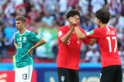 Thomas Mueller of Germany looks dejected following his sides defeat as Yun Young-Sun and Lee Jae-Sung celebrate after the 2018 FIFA World Cup Russia group F match between Korea Republic and Germany at Kazan Arena on June 27, 2018 in Kazan, Russia.