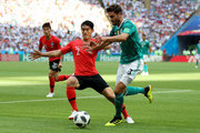Jonas Hector of Germany is challenged by Yong Lee of Korea Republic during the 2018 FIFA World Cup Russia group F match between Korea Republic and Germany at Kazan Arena on June 27, 2018 in Kazan, Russia.