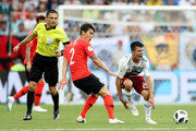 Hirving Lozano of Mexico is fouled by Yong Lee of Korea Republic during the 2018 FIFA World Cup Russia group F match between Korea Republic and Mexico at Rostov Arena on June 23, 2018 in Rostov-on-Don, Russia.