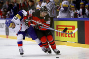 Minho Cho (L) of Korea and Brayden Schenn of Canada battle for the puck during the 2018 IIHF Ice Hockey World Championship group stage game between Korea and Canada at Jyske Bank Boxen on May 6, 2018 in Herning, Denmark.