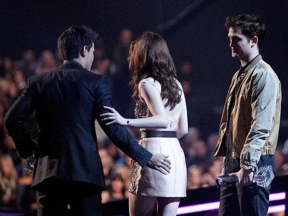 Kristen Stewart (L-R) Actors Taylor Lautner, Kristen Stewart and Robert Pattinson accept the Favorite Movie award onstage during the 2011 People's Choice Awards at Nokia Theatre L.A. Live on January 5, 2011 in Los Angeles, California.