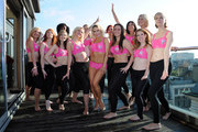 Kris Hallenga and Kristina Rhianoff (C) attend a photocall to launch a Breast Cancer Awareness sports bra on October 9, 2012 in London, England.