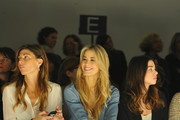 (L-R)Alessandra Grillo, Elena Santarelli and  Valentina Scambia and Virginia Galateri attend the Kristina T Show during Milan Fashion Week Womenswear Autumn/Winter 2014 on February 20, 2014 in Milan, Italy.