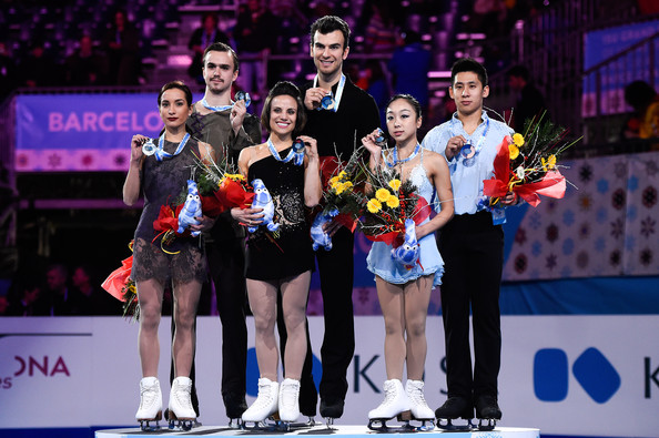ISU Grand Prix of Figure Skating Final 2014/2015 - Day Three [figure skating,ice skating,skating,sports,recreation,competition,championship,silver medal,event,competition event,ksenia stolbova,cong han,wenjing sui,media,l-r,barcelona international convention centre,canada,china,isu grand prix of figure skating final,medals ceremony]