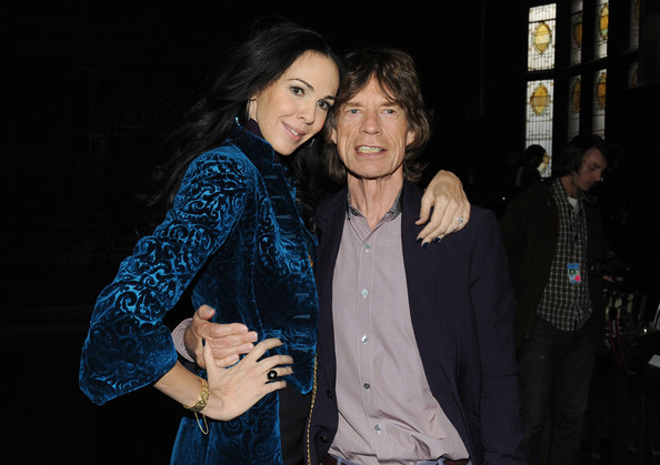 Designer L'Wren Scott and musician Mick Jagger pose at the L'Wren Scott Fall 2012 fashion show during Mercedes-Benz Fashion Week at  the Desmond Tutu Center on February 16, 2012 in New York City.