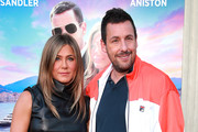 "(L-R) Jennifer Aniston and Adam Sandler attend the LA premiere of Netflix's ""Murder Mystery"" at Regency Village Theatre on June 10, 2019 in Westwood, California."
