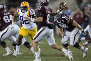 Trevor Knight #8 of the Texas A&M Aggies throws a pass as he his pressured by Lewis Neal #92 of the LSU Tigers at Kyle Field on November 24, 2016 in College Station, Texas.